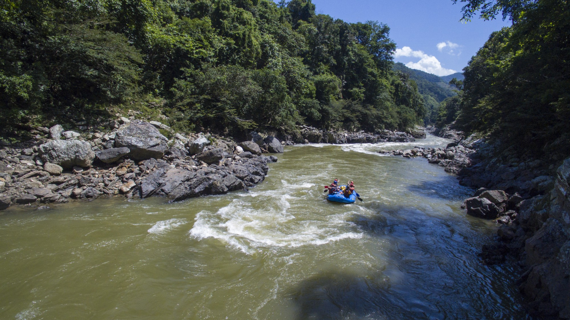 Blue raft descending the Rio Samana in Colombia