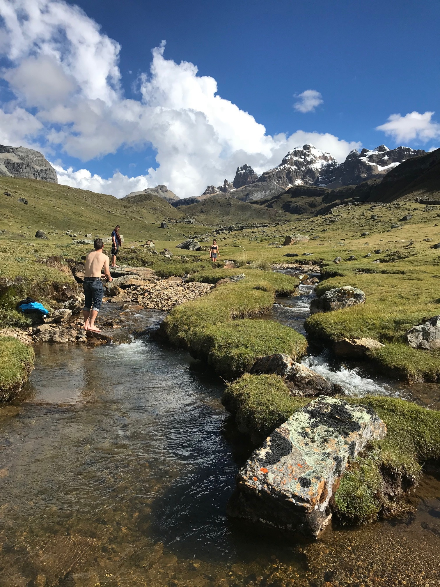 Bathing in the mountains in a grassy valley