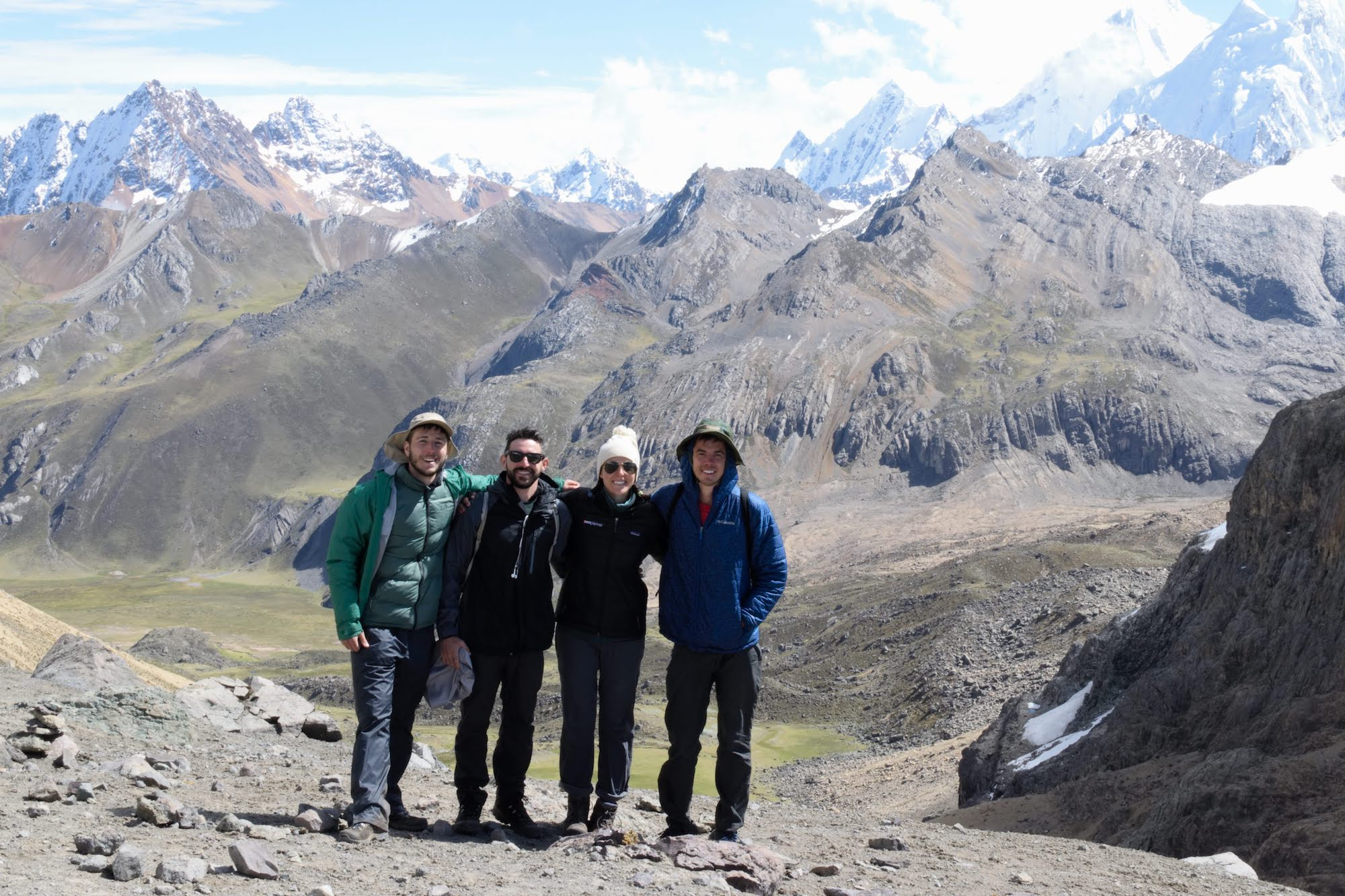 A group photo at the top of a valley