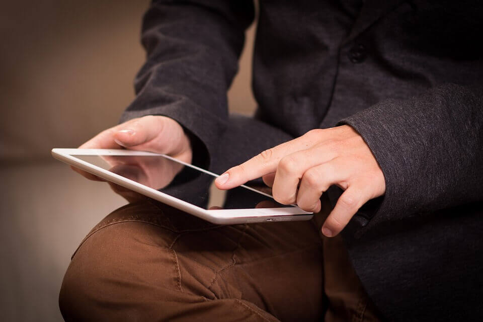 A man using an I-pad