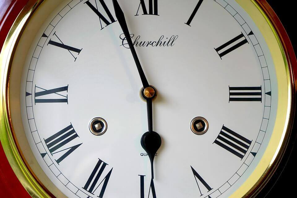 A close up of a traditional clock