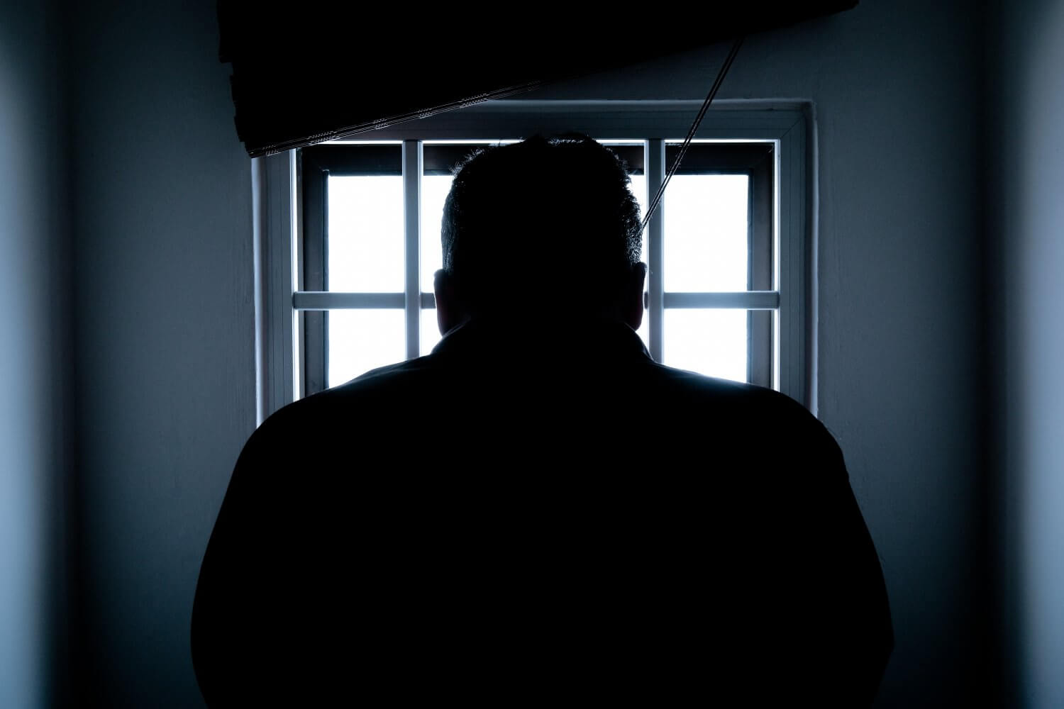 A man standing in a dark room