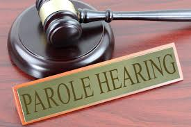 """A name tag that says """"Parole Hearing"""""""