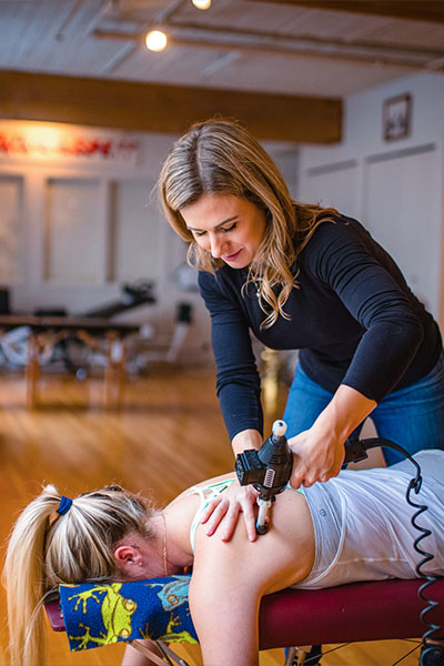 Claire Kassain  doing spinal decompression in Vancouver