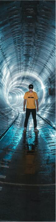 man posing inside a tunnel