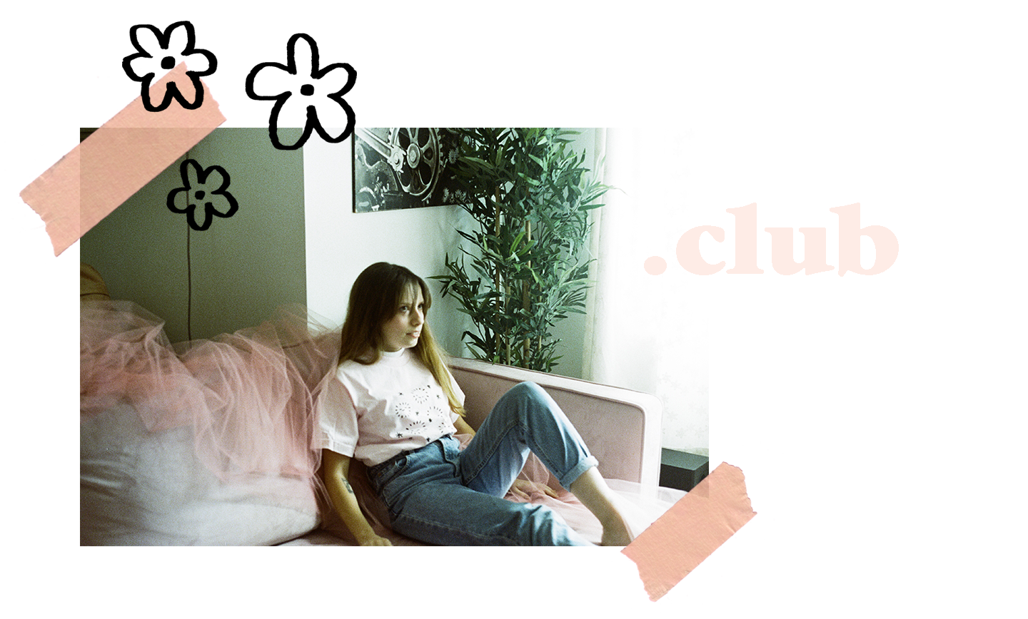 Girl model sitting on pink couch wearing pink pollen shirt.