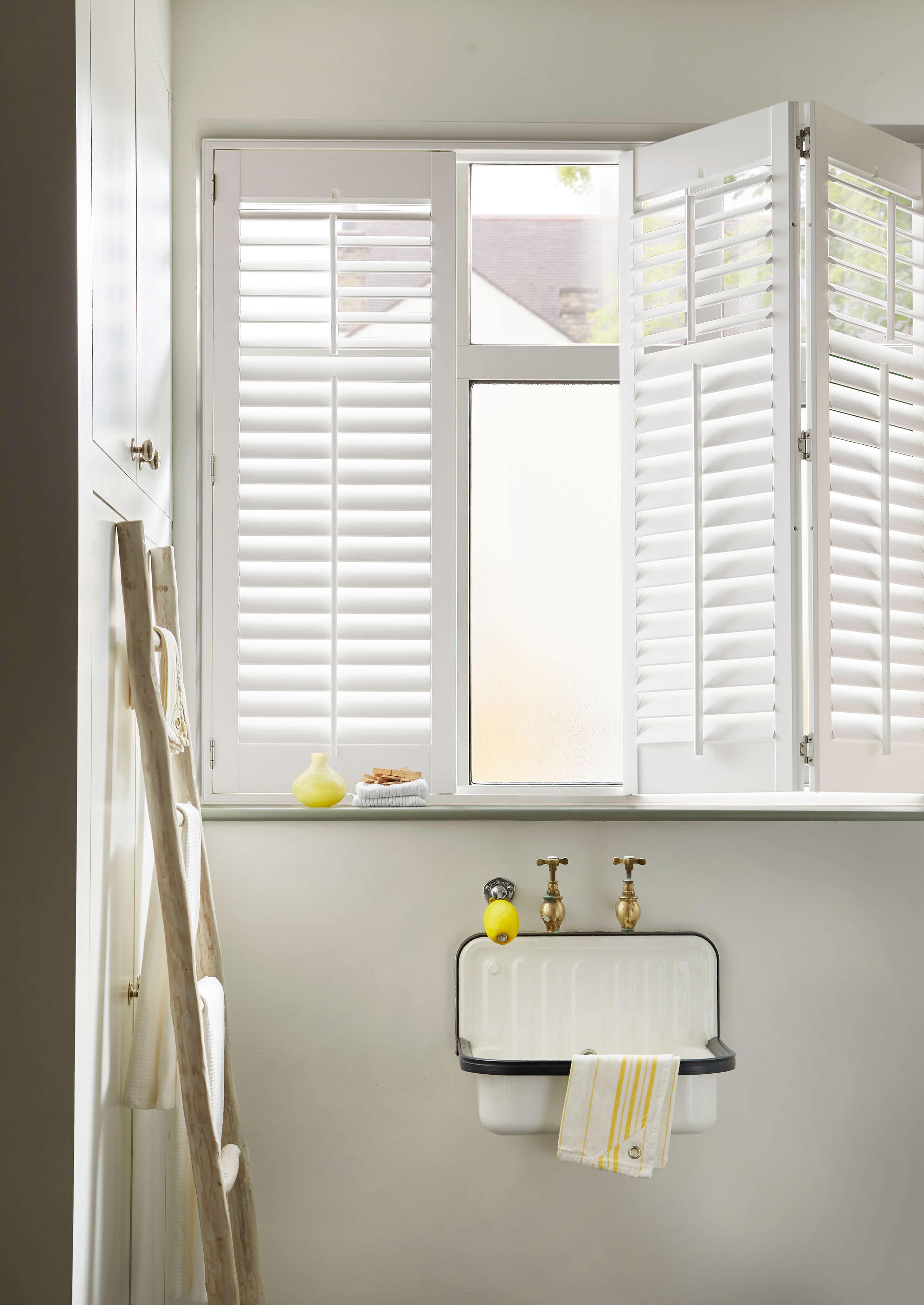 ABS shutter in bathroom setting with bi-fold door