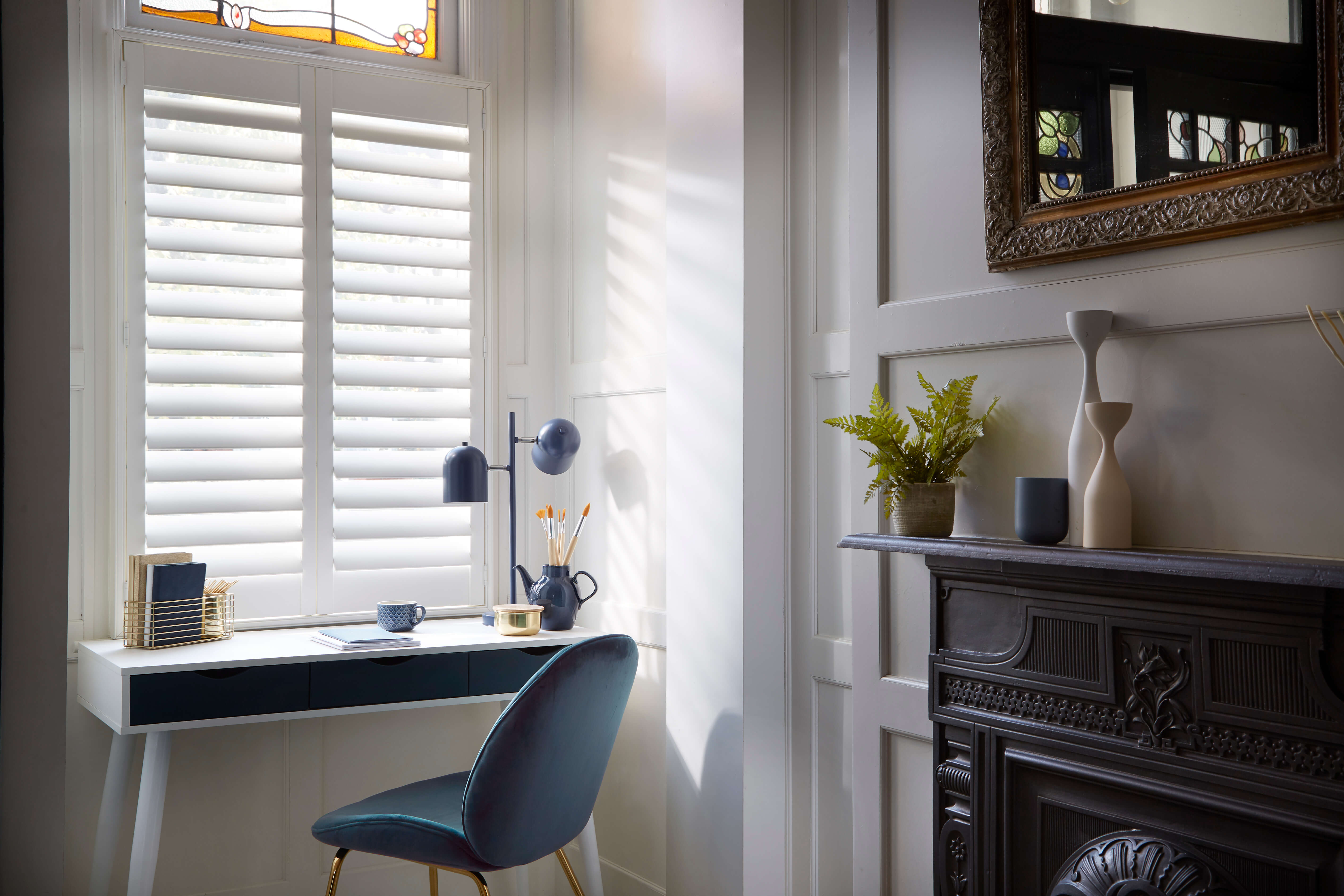 cafe style shutters exposing traditional leaded windows