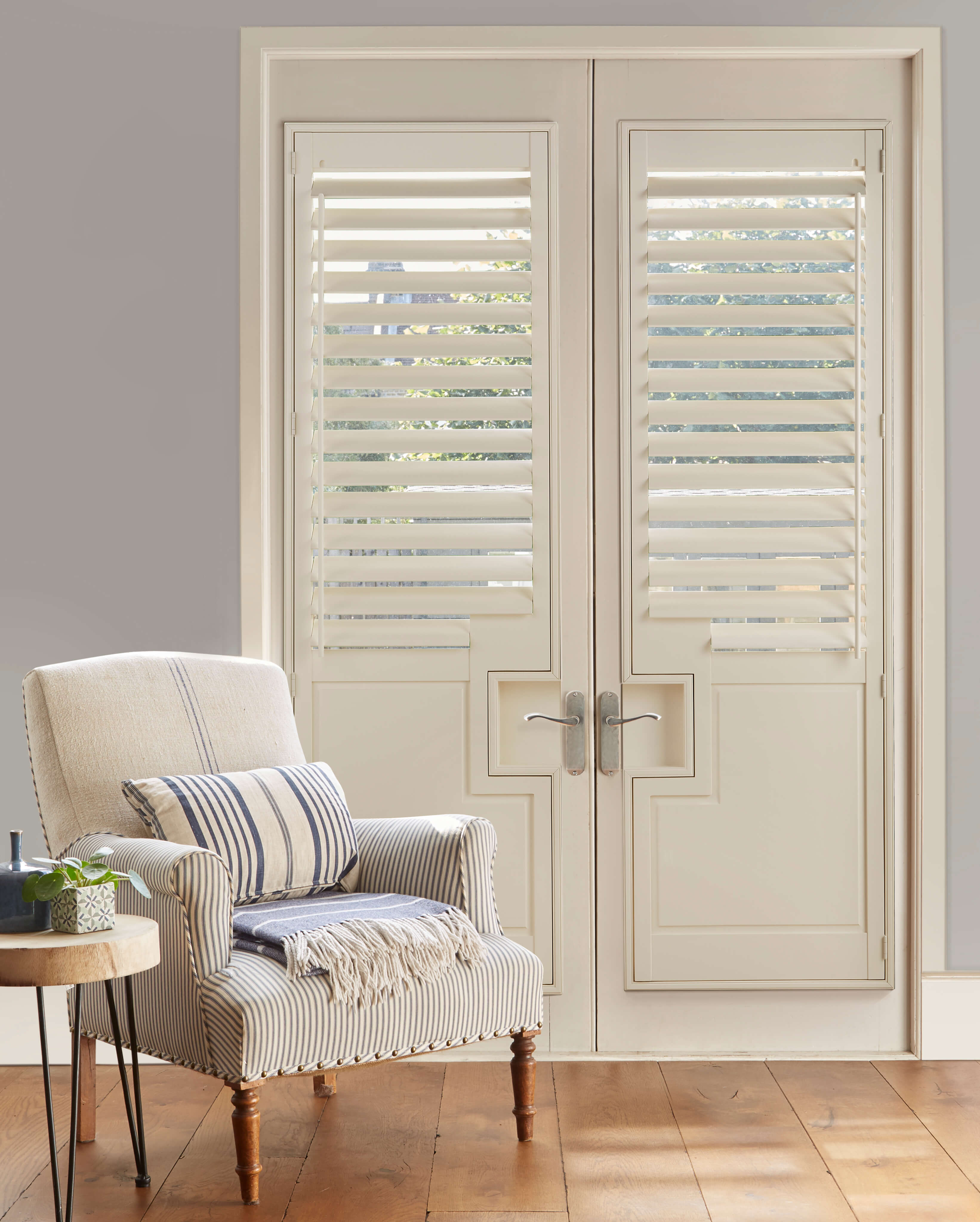tracked shutters with lower solid panels