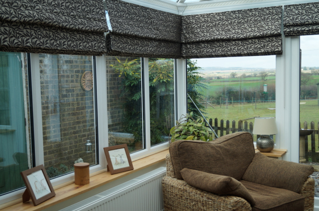 Patterned roman blinds fitted in a conervatory