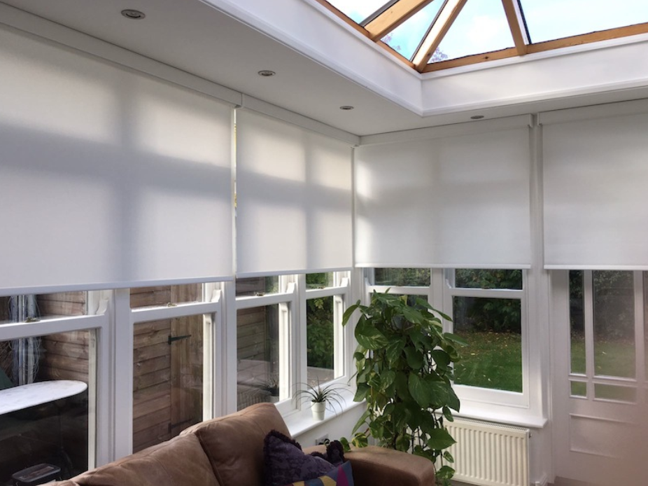Roller blinds fitted in a conservatory with a roof light