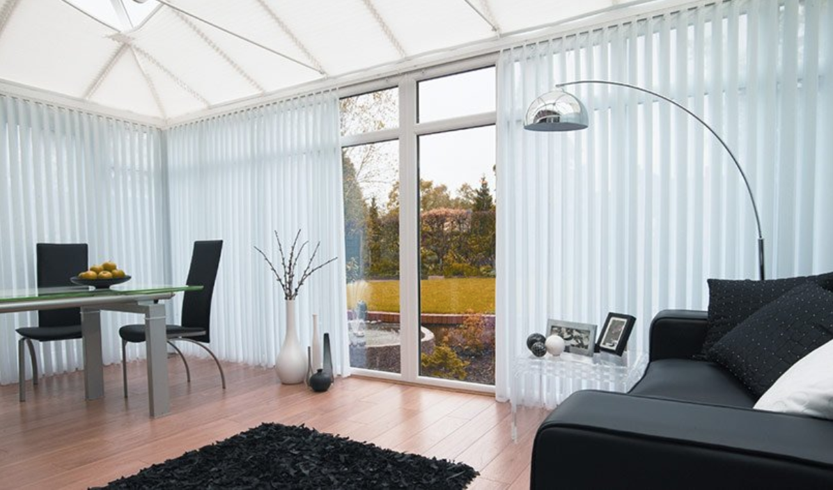 White full length vertical blinds in a conservatory