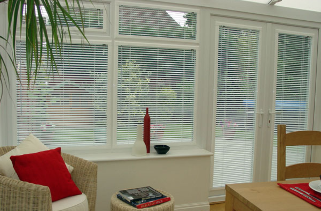 Perfect Fit venetian blind fitted in a modern conservatory
