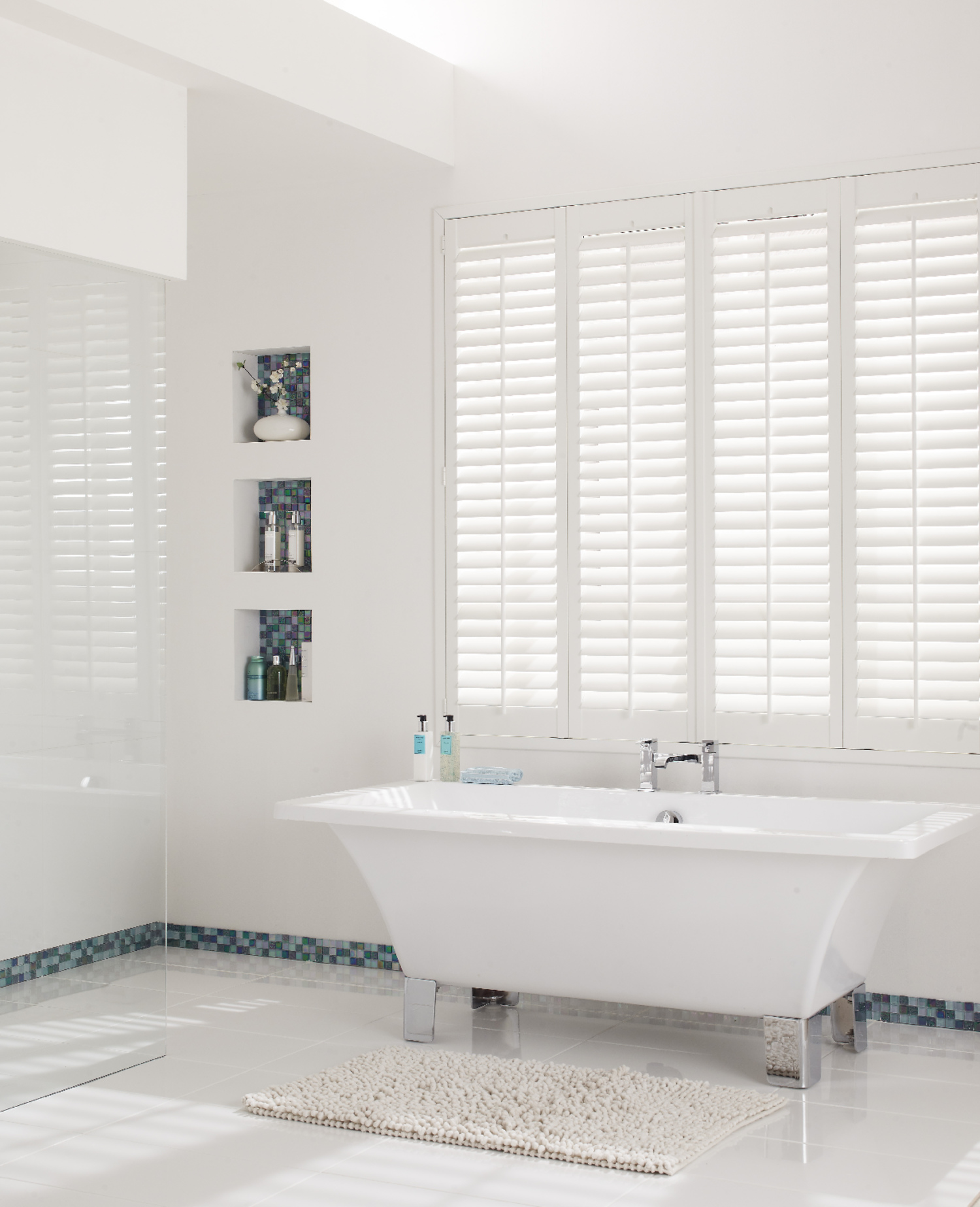 white uPVC shutters in large open bathroom