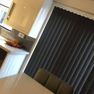 Grey vertical blinds on french doors