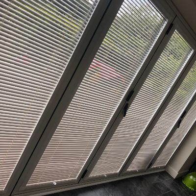 stunning white perfect fit venetian blinds on bi-fold doors