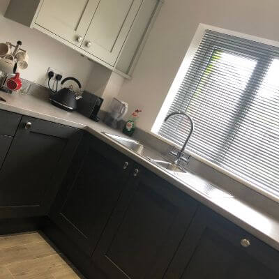 Light grey metal venetian blind fitted in kitchen