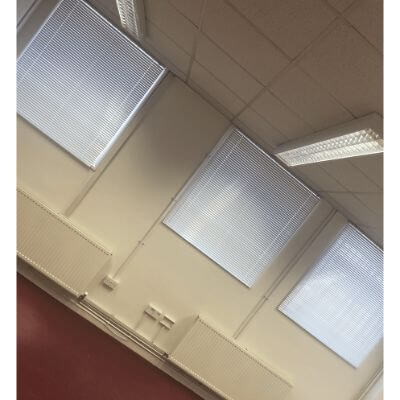 White metal venetian blinds fitted in commercial office