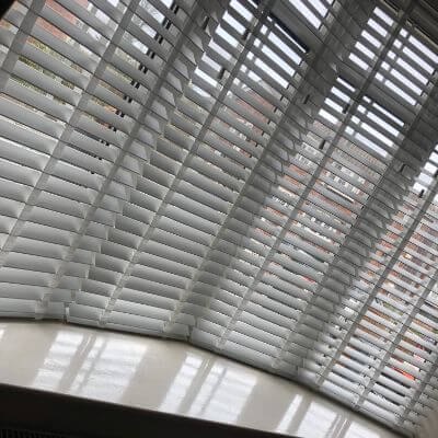 5 x faux wood venetian blinds fitted in bay
