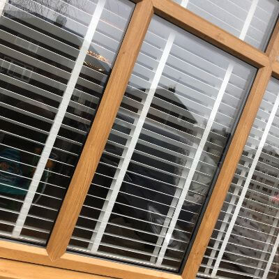 White faux wood blinds with tapes viewed from outside
