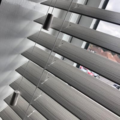Faux wood venetian blind in mixture of white and grey