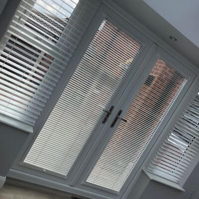 Faux wood venetian blind fitted in conservatory with perfect fit doors