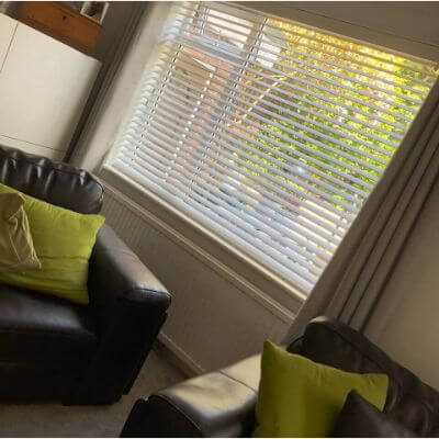 Faux wood venetian blind adding light to a living room