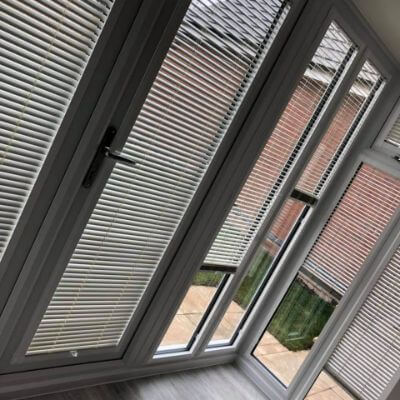 white metal venetian blinds in perfect fit system on conservatory pod