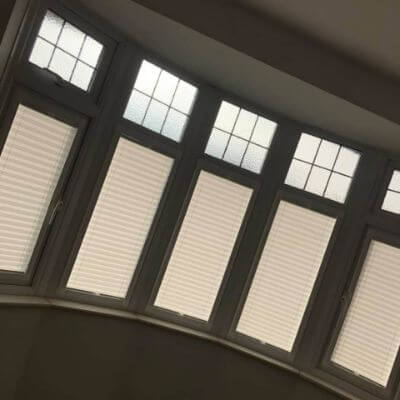 cream pleated blinds in 5 section bay