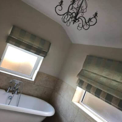 striped roman blinds in classic style bathroom