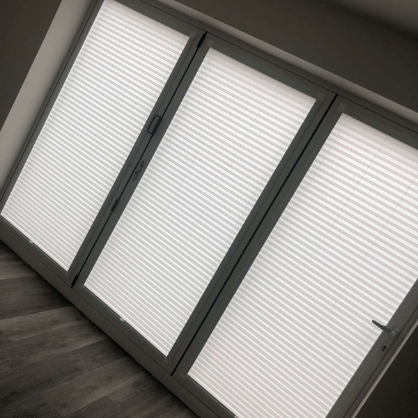 white pleated blinds used on bi-fold doors