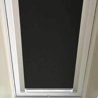 black skylight blind fitted with channels