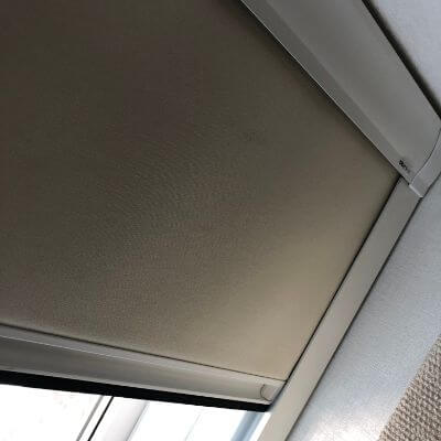 100% blackout blind fitted with channels in neutral fabric