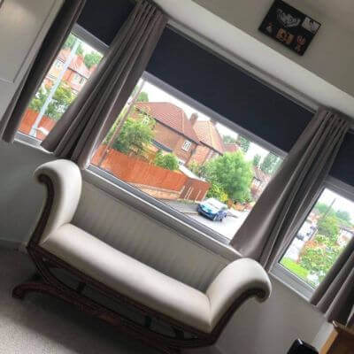 Blackout grey roller blinds in bedroom