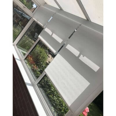 remote control roller blinds fitted in conservatory