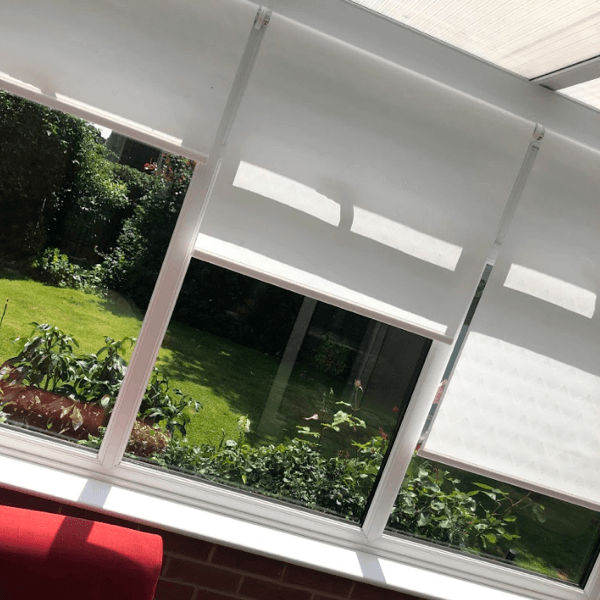 white remote control blinds in conservatory