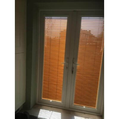 Copper coloured venetian blinds in perfect fit system