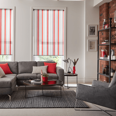 a mixture of bright and subtle red and pink vertical blind slats