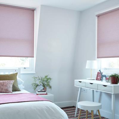 a subtle blush pink roller blind fabric