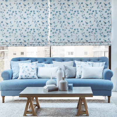 two matching blue roman blinds