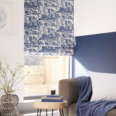 intricate pattern on blue roman blind material