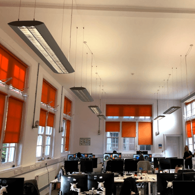 full office of roller blinds fitted into converted mill building