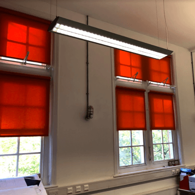orange roller blinds fitted to match with companies colour scheme