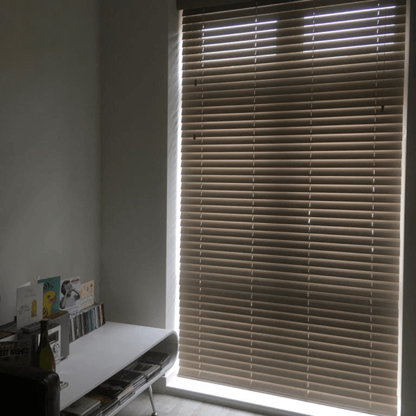 Long drop faux wood blind in new build home
