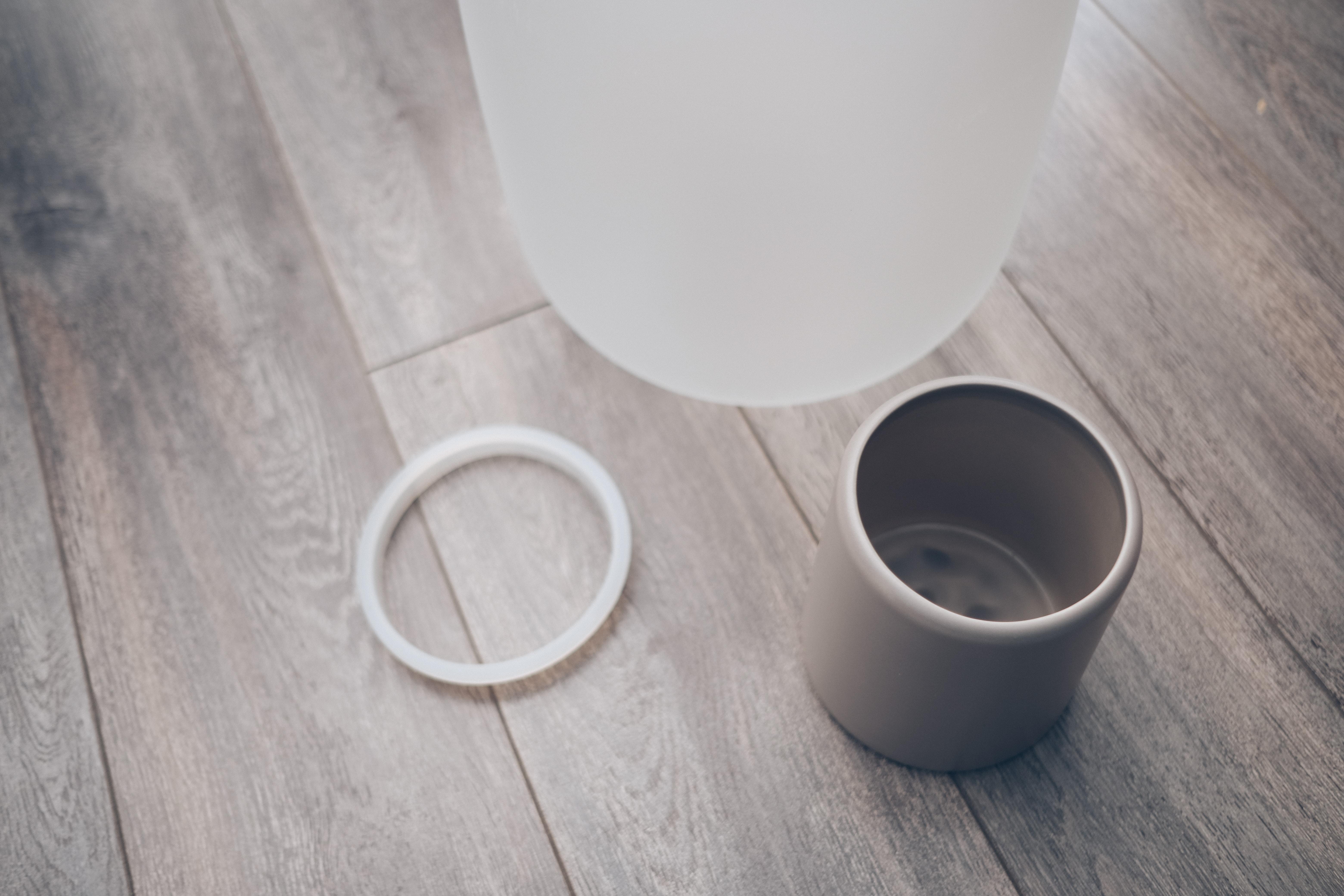 gest nebl vase in pieces on the floor