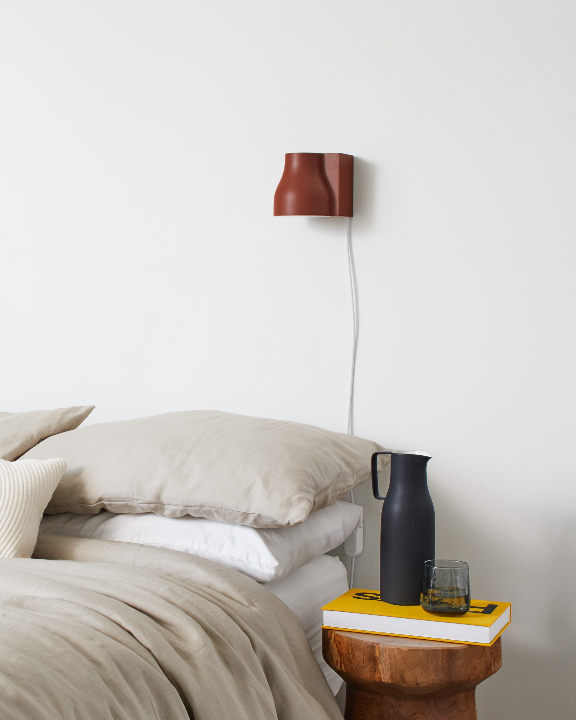 Wall mounted light above bed