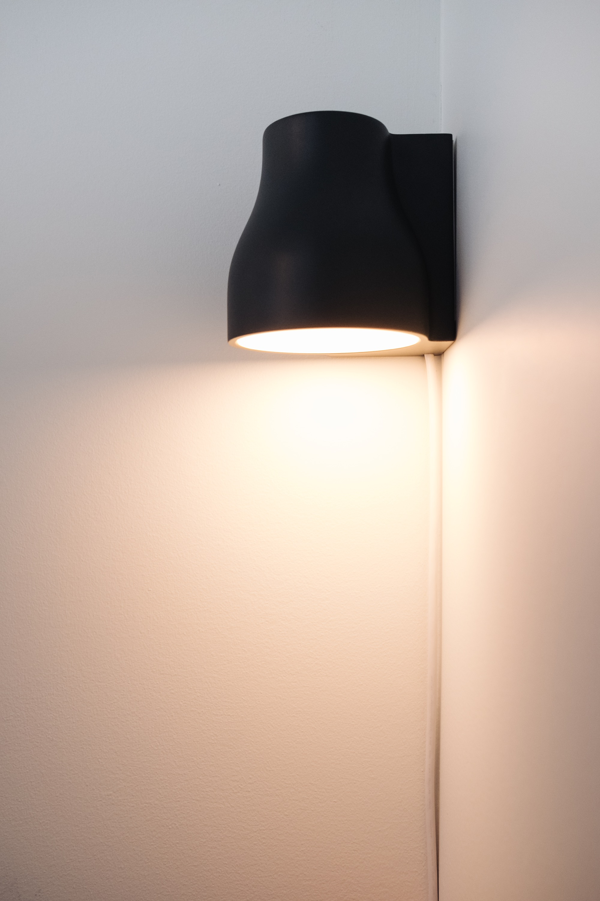 Lamp in corner with light on