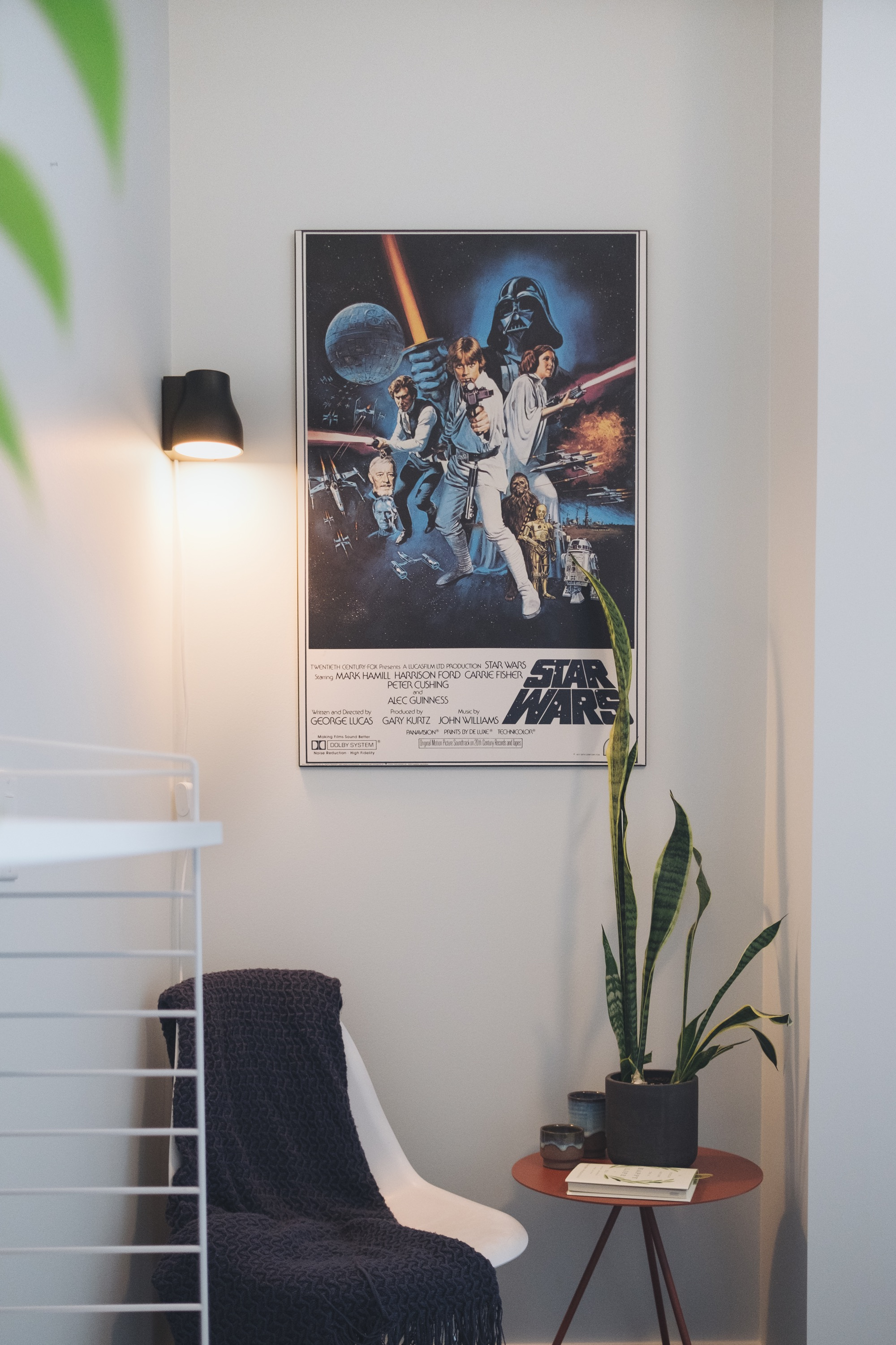 Lamp in office with poster and plants
