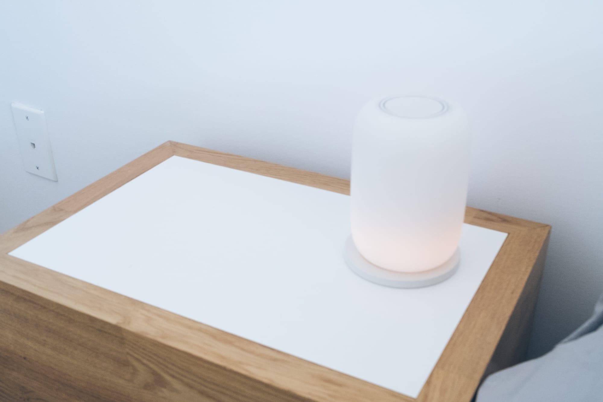 Casper glow lamp sitting on bedside table