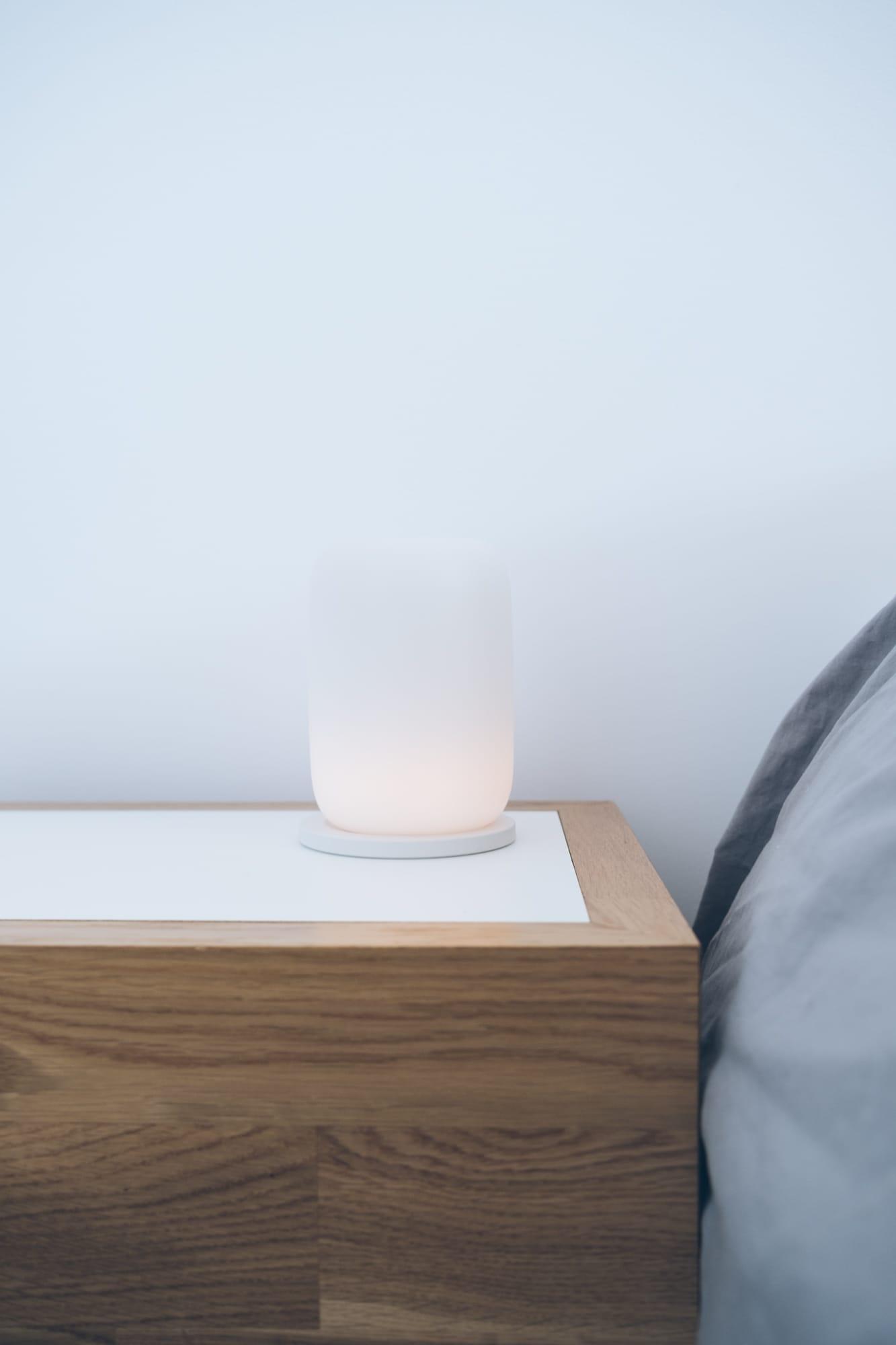gasper glow lamp sitting on nightstand.